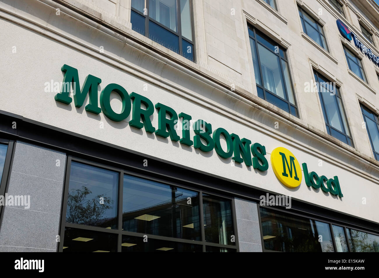 Morrisons M Local store sign in Manchester Piccadilly Gardens UK - Stock Image