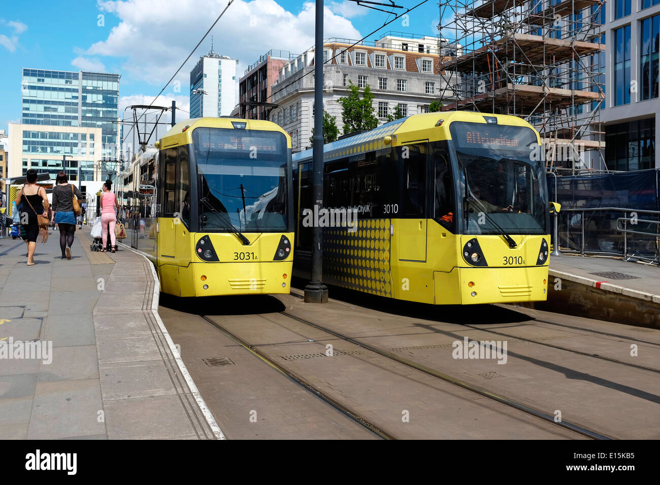 Two yellow Metrolink trams at St Peters Square Station in Manchester city centre UK - Stock Image
