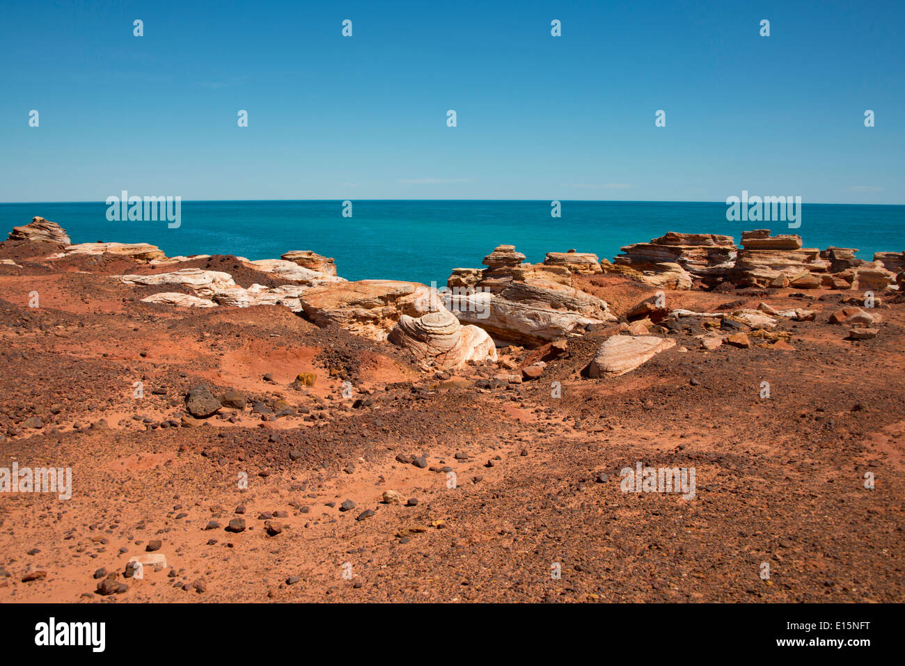 Australia, Western Australia, Broome. Gantheaume Point. Indian Ocean view of the rocky red cliffs. - Stock Image