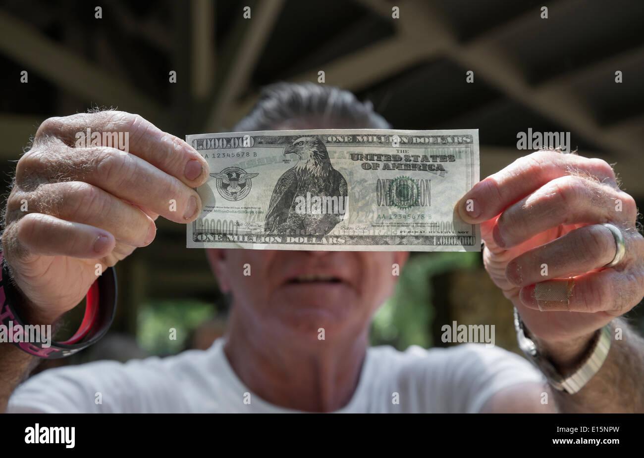 Man holds a fake million dollar bill. Stock Photo