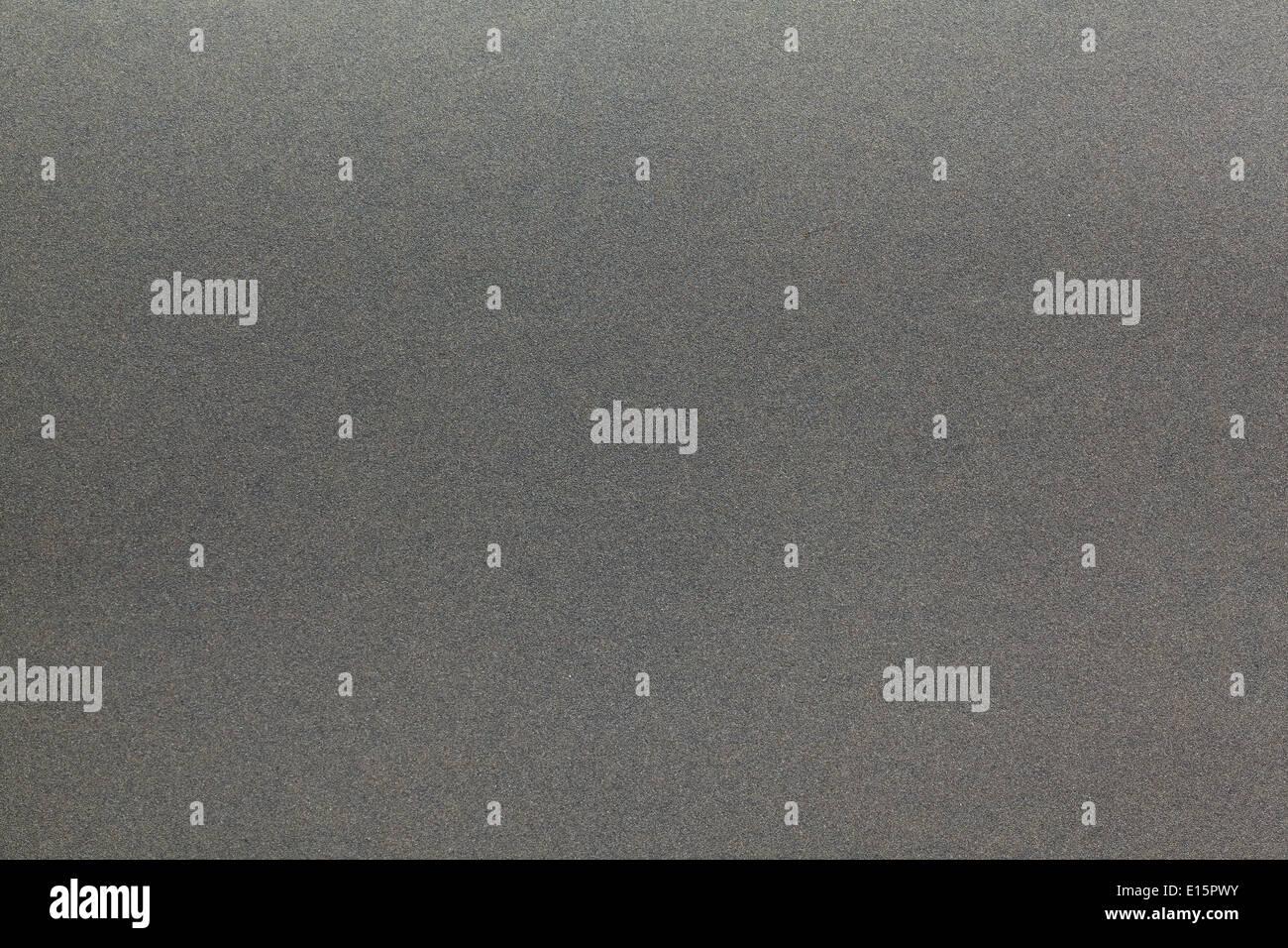 sheet of black sandpaper for background - Stock Image