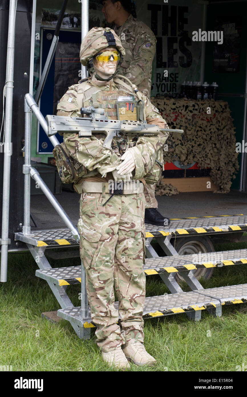 Male Mannequin Dressed in Army combat gear with assault riffle at a military show Stock Photo