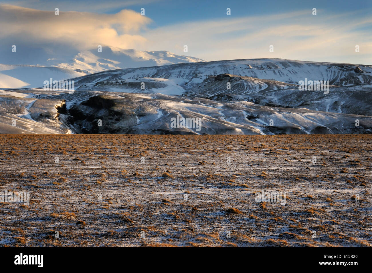 Icelandic landscape with view on the Hekla volcano and frozen lava field, Iceland. - Stock Image