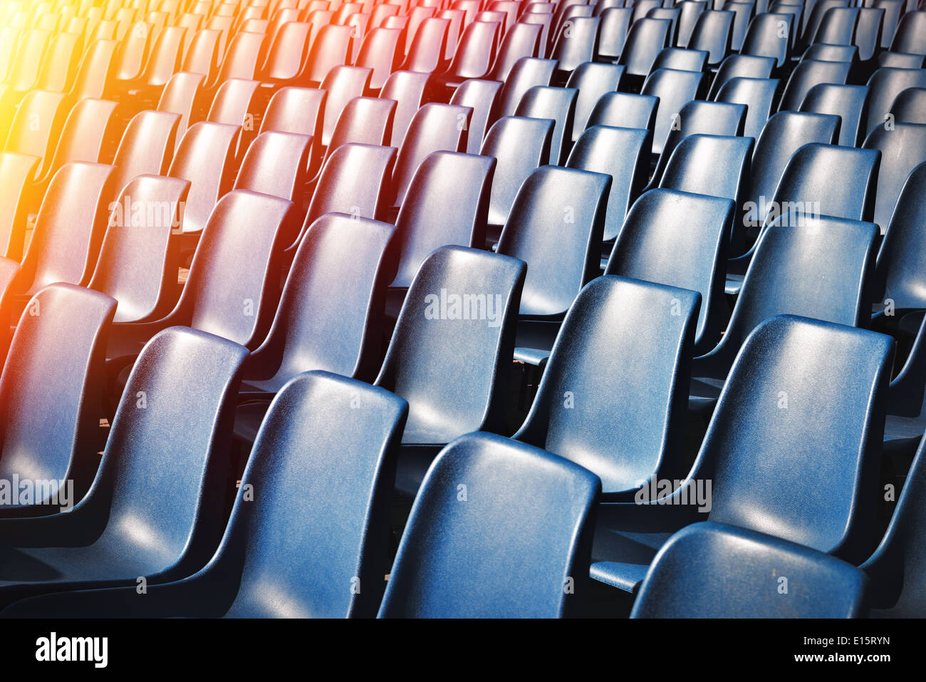 Empty plastic chairs at the stadium with toning effect & Empty plastic chairs at the stadium with toning effect Stock Photo ...