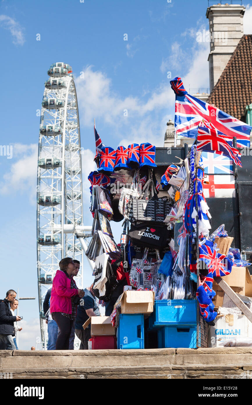 Tourists souvenir stall with London Eye. - Stock Image