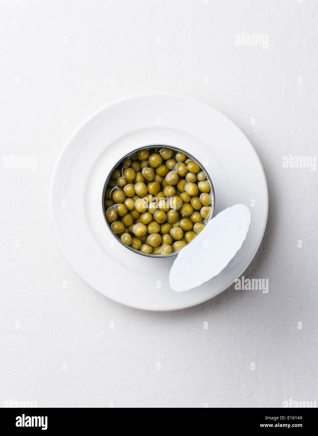Canned green peas in tin can - Stock Image
