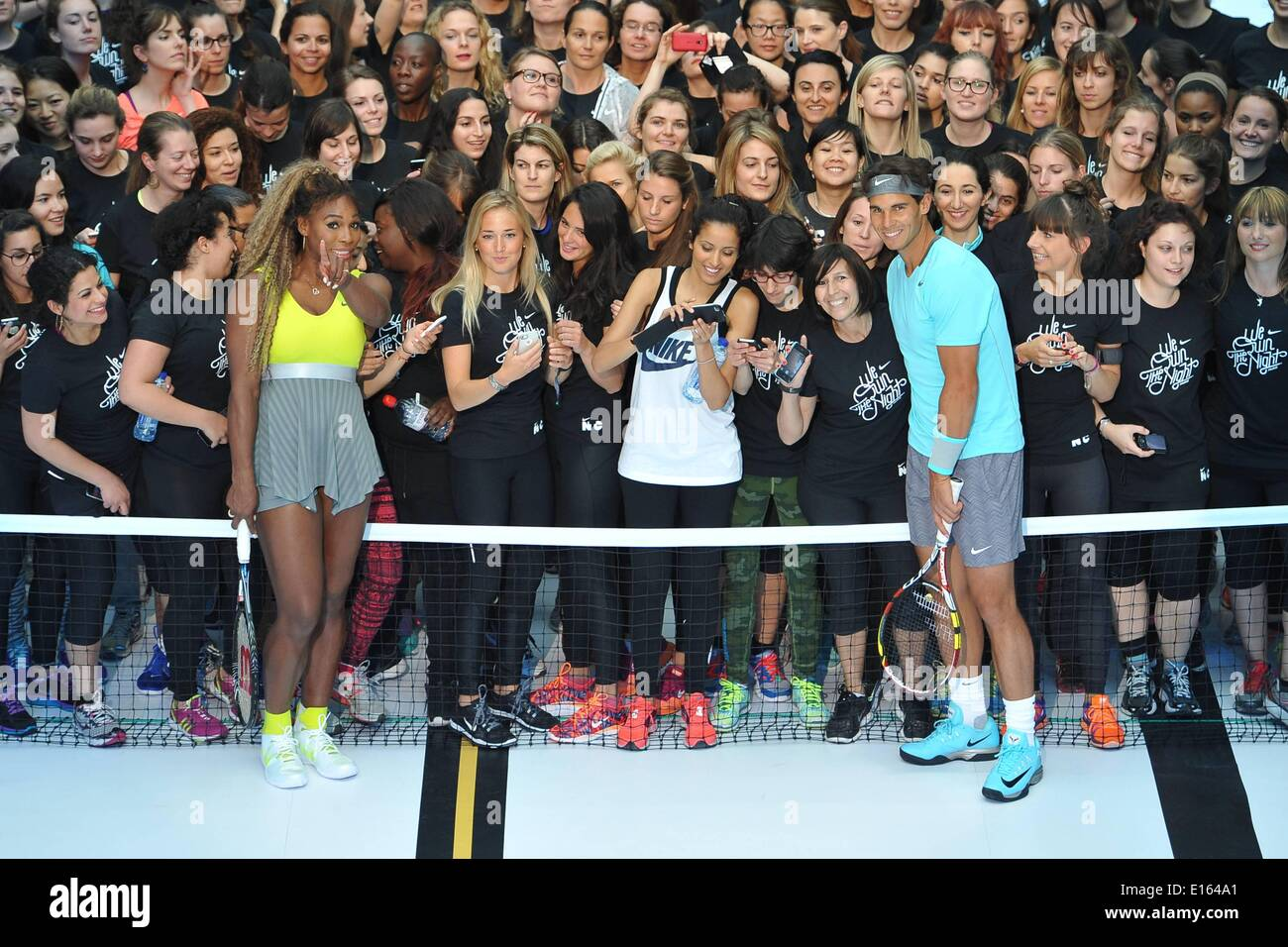 Paris, France. 23rd May, 2014. Molitor Swimming Pool, Paris, France. 23rd May, 2014. US tennis player Serena Williams (L) and Spain's tennis player Rafael Nadal are pictured with the children after exchanging balls on a tennis court set up in a swimming pool at the Molitor luxury swimming pool complex in Paris as part of a Nike Tennis promotion Credit:  Action Plus Sports/Alamy Live News - Stock Image