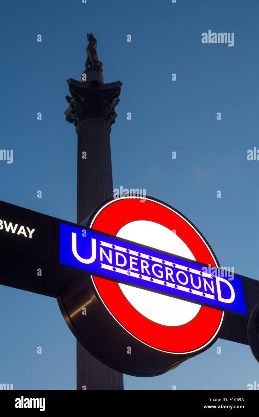 Trafalgar Square Tube subway Underground station sign roundel with Nelson's Column above London England UK - Stock Image