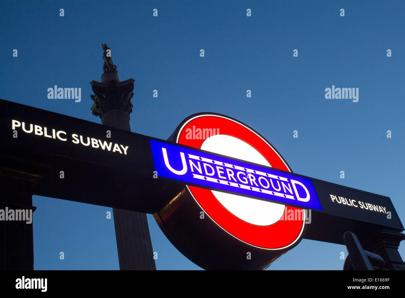 Trafalgar Square Tube subway Underground station and public subway sign roundel with Nelson's Column above London England UK - Stock Image