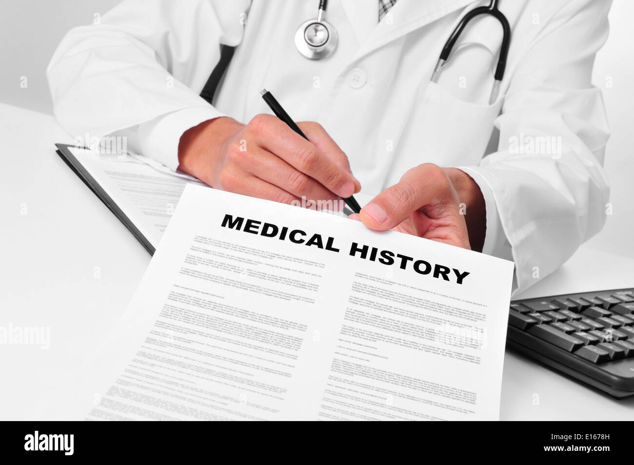 doctor in his office showing a medical history Stock Photo