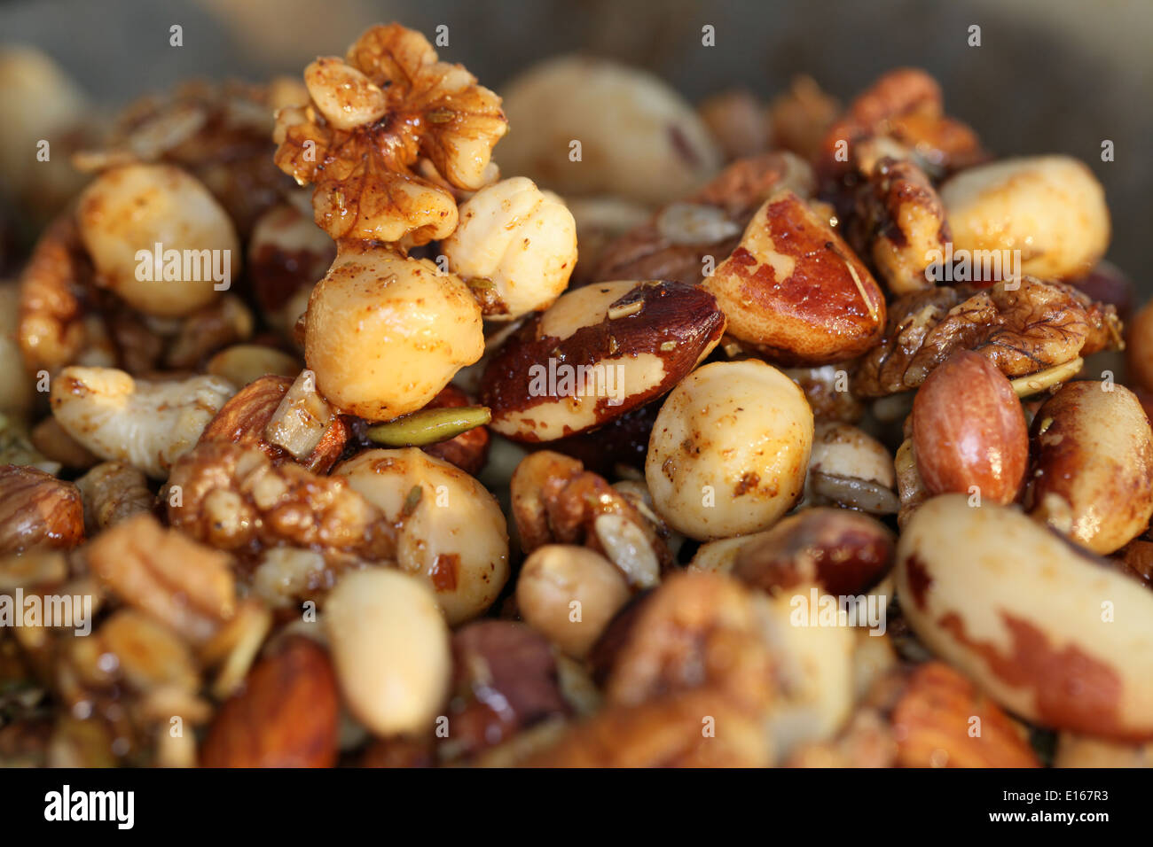 A Nutty,spicy snack. Nuts drizzled with warm spiced honey - Stock Image
