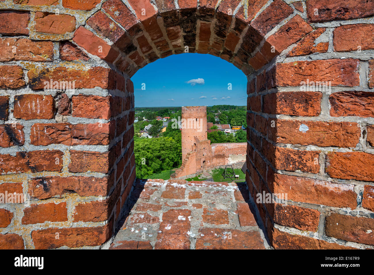 West Tower seen through embrasure at South Tower of medieval Mazovian Princes Castle near village of Czersk, Mazovia, Poland - Stock Image