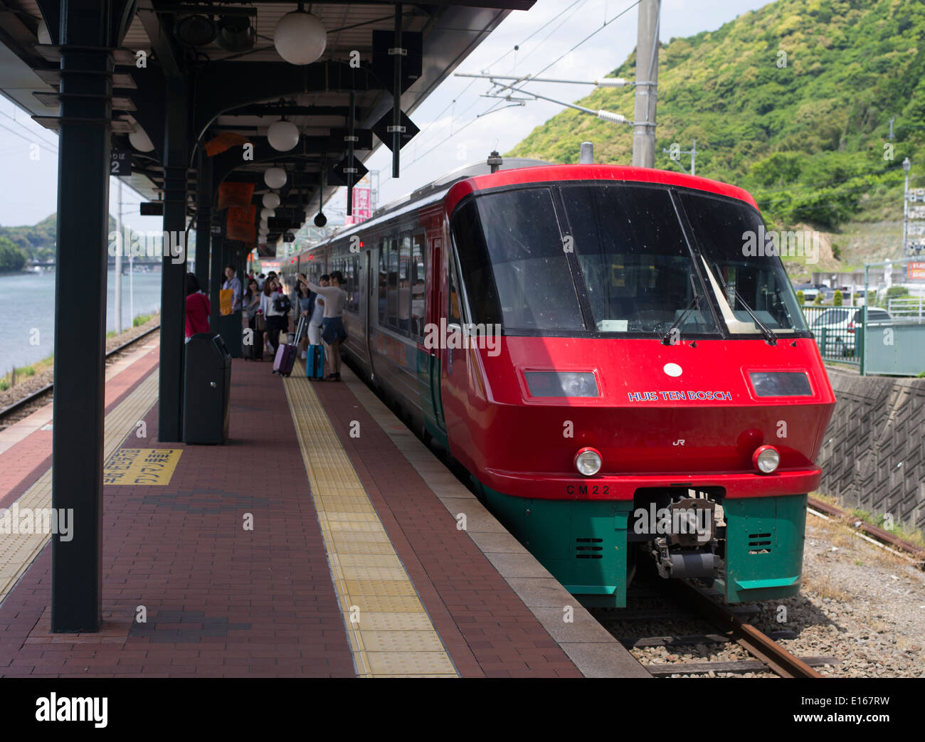 JR Express train arrives at Huis Ten Bosch, a theme park in Sasebo, Nagasaki, Japan. Recreates Netherlands and dutch buildings. - Stock Image