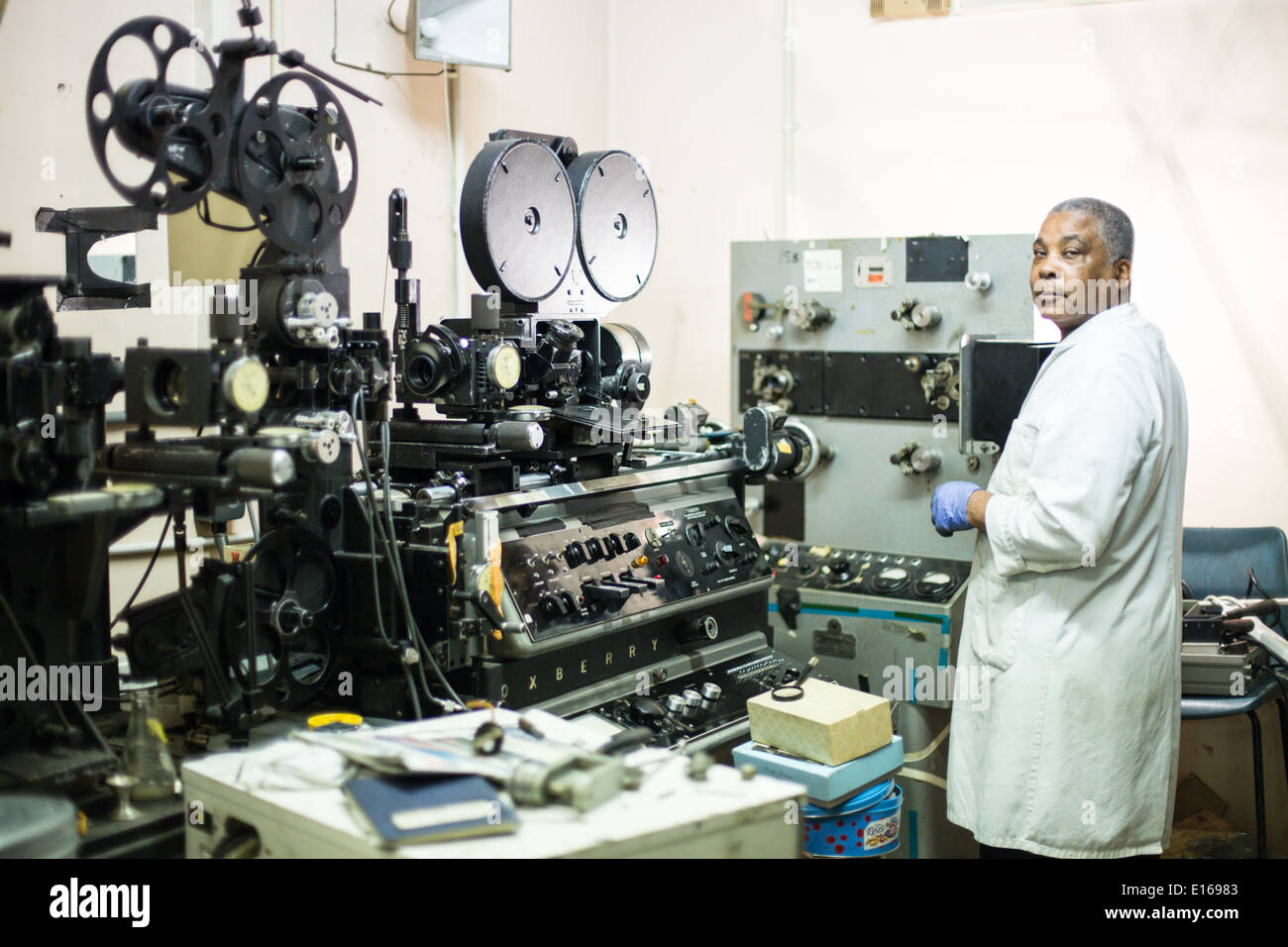 technician in lab processing film with oxberry equipment in background - Stock Image