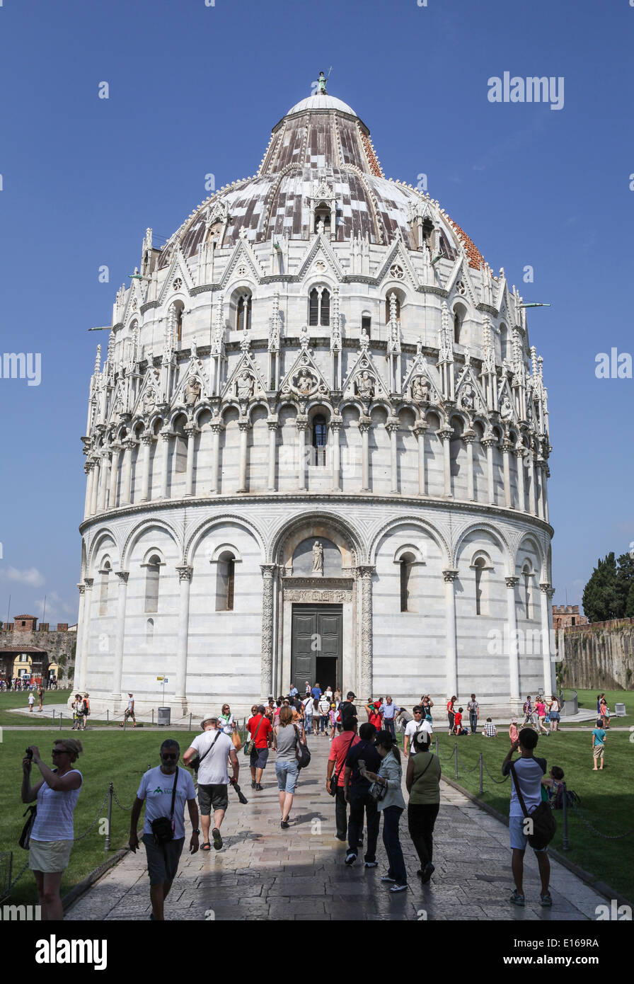 Tourists strolling around The Baptistry of St. John at the Piazza dei Miracoli in the Tuscany city of Pisa, Italy. Stock Photo