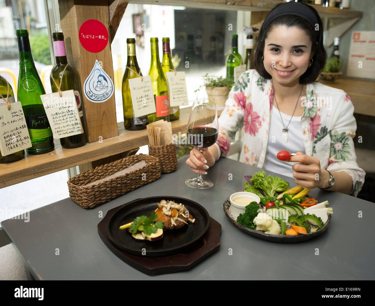 Customer (model released) eating at Ukishima Garden vegan cafe /  restaurant, Naha, Okinawa - Stock Image