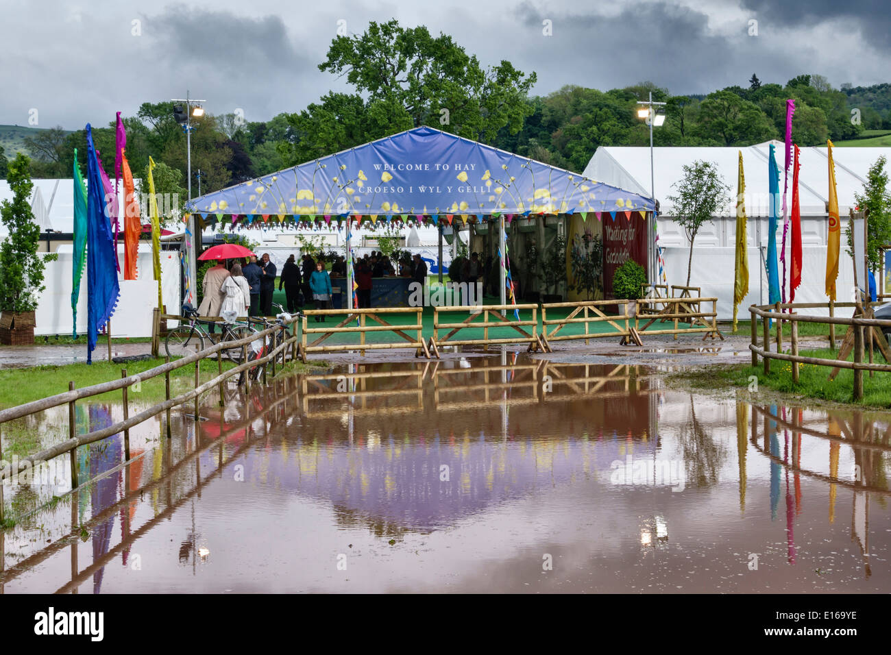 A wet day at the 2014 Hay Festival of Literature - the flooded entrance to the site - Stock Image