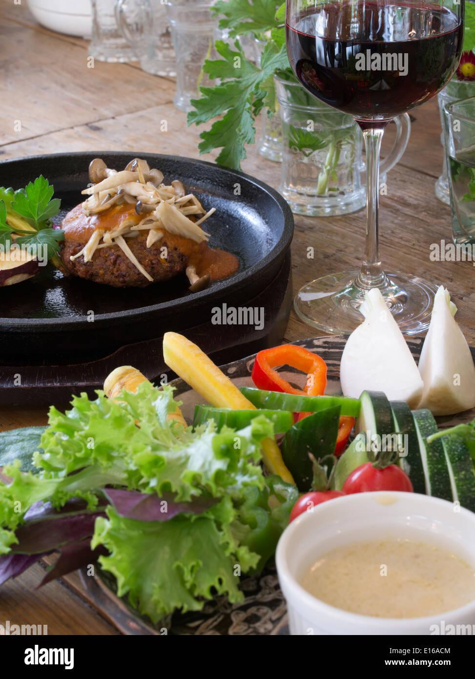 Organic locally grown vegetables at Ukishima Garden vegan restaurant, Naha, Okinawa - Stock Image