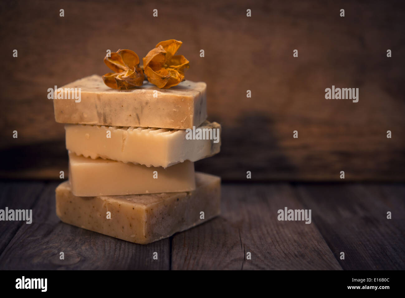 Handmade vegan soap in low light ambient setting with blank copy space. - Stock Image