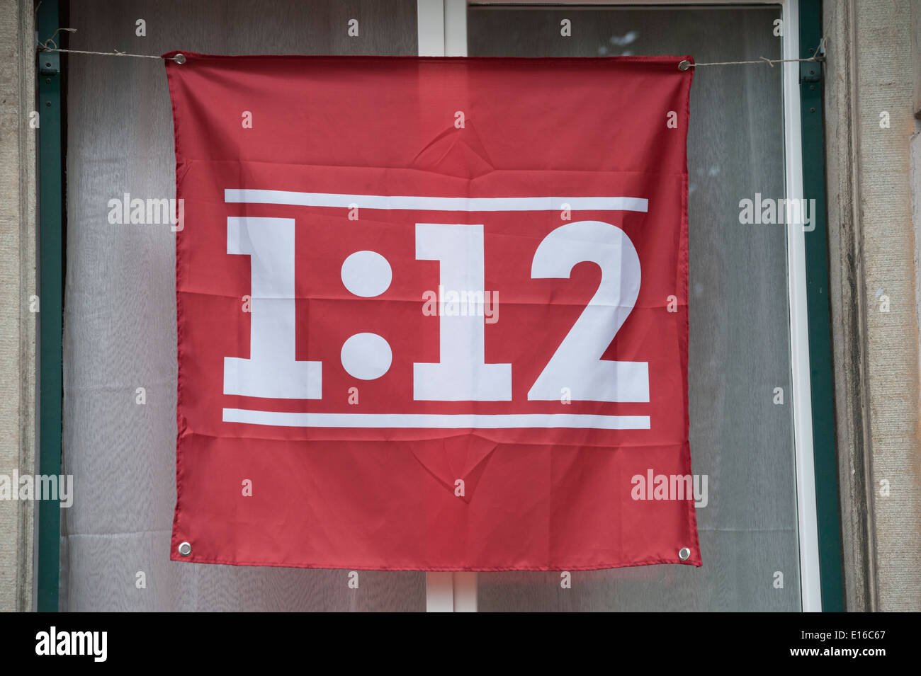 Flags supporting the '1:12 Initiative' (aka 'Fat Cat')  to limit manager pay are hanging off buildings - Stock Image