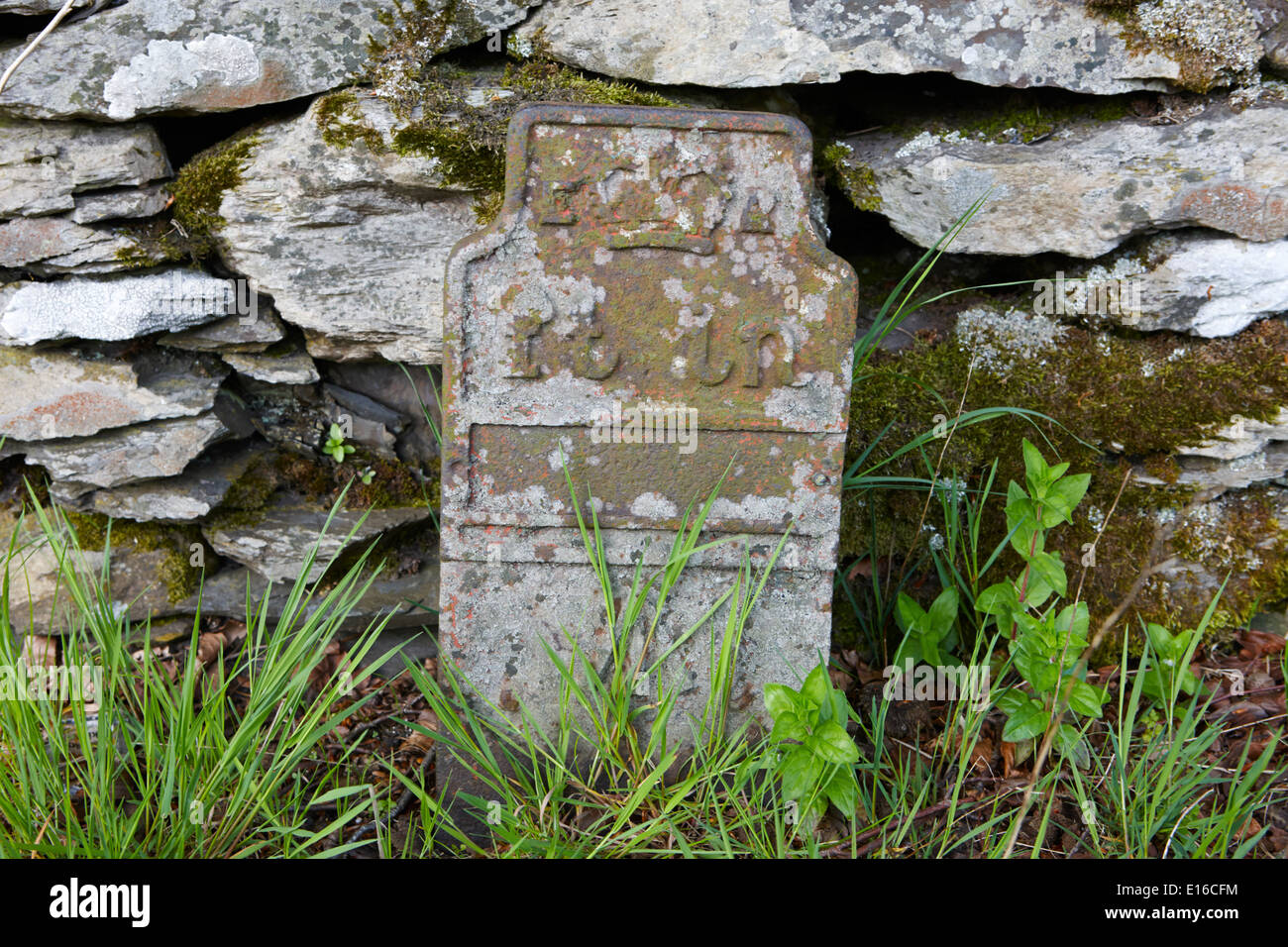 old cast iron bench mark in feet and inches on the roadside of the A6 cumbria uk - Stock Image