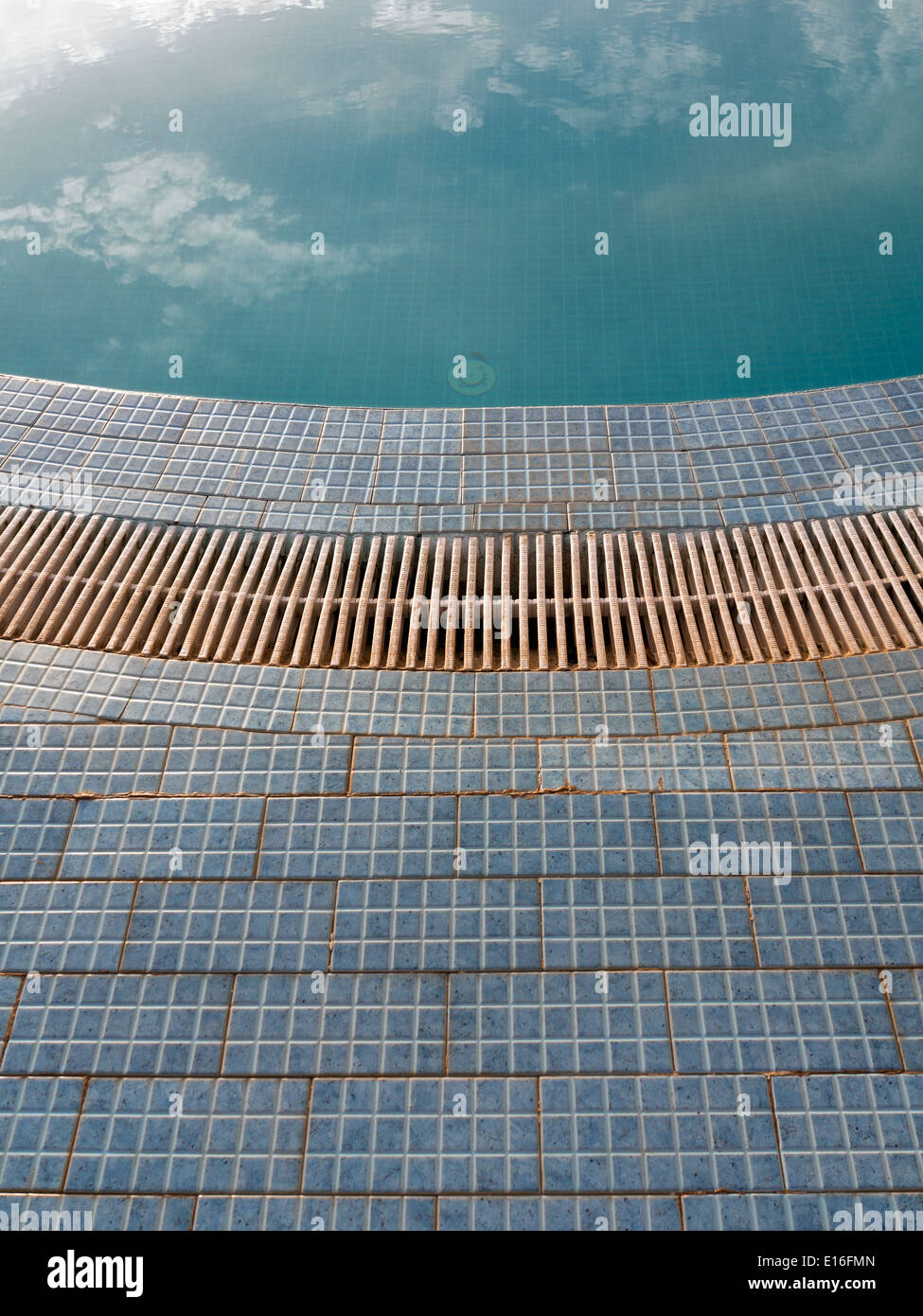 Close up details of floor tiles and drainage edge on a swimming pool ...