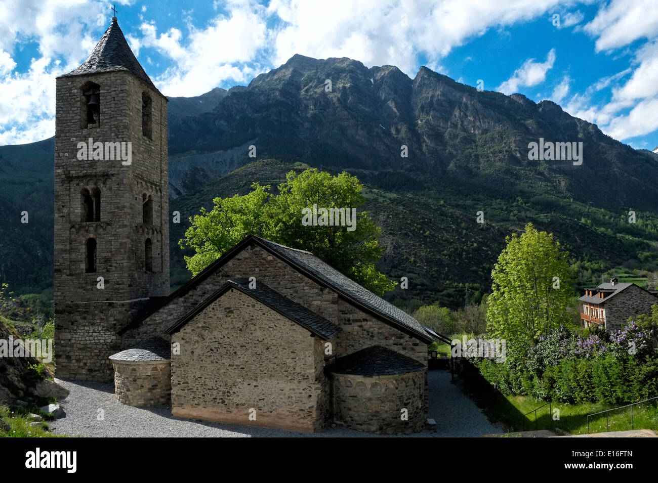 Exterior view of the Catalan Romanesque Church of Sant Joan situated in Vall de Boi valley in the high Pyrenees Catalonia Spain - Stock Image