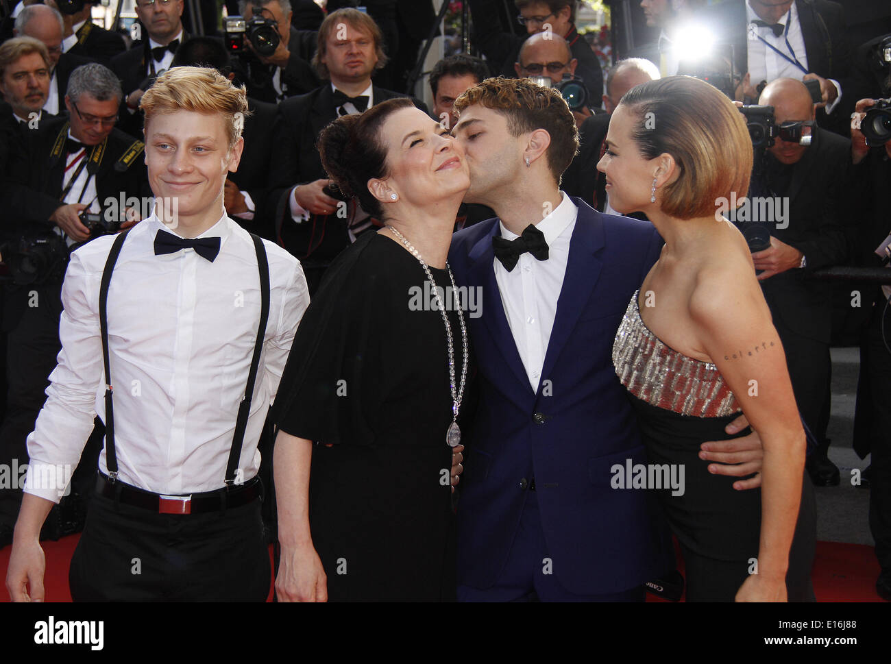 Cannes, France. 24th May, 2014. Actor Antoine-Olivier Pilon, actress Anne Dorval, director Xavier Dolan and actress Suzanne Clement (from L to R) arrive for the screening of 'Per un pugno di dollari' (A Fistful of Dollars) and the closing award ceremony of the 67th Cannes Film Festival, in Cannes, France, May 24, 2014. Credit:  Ye Pingfan/Xinhua/Alamy Live News - Stock Image