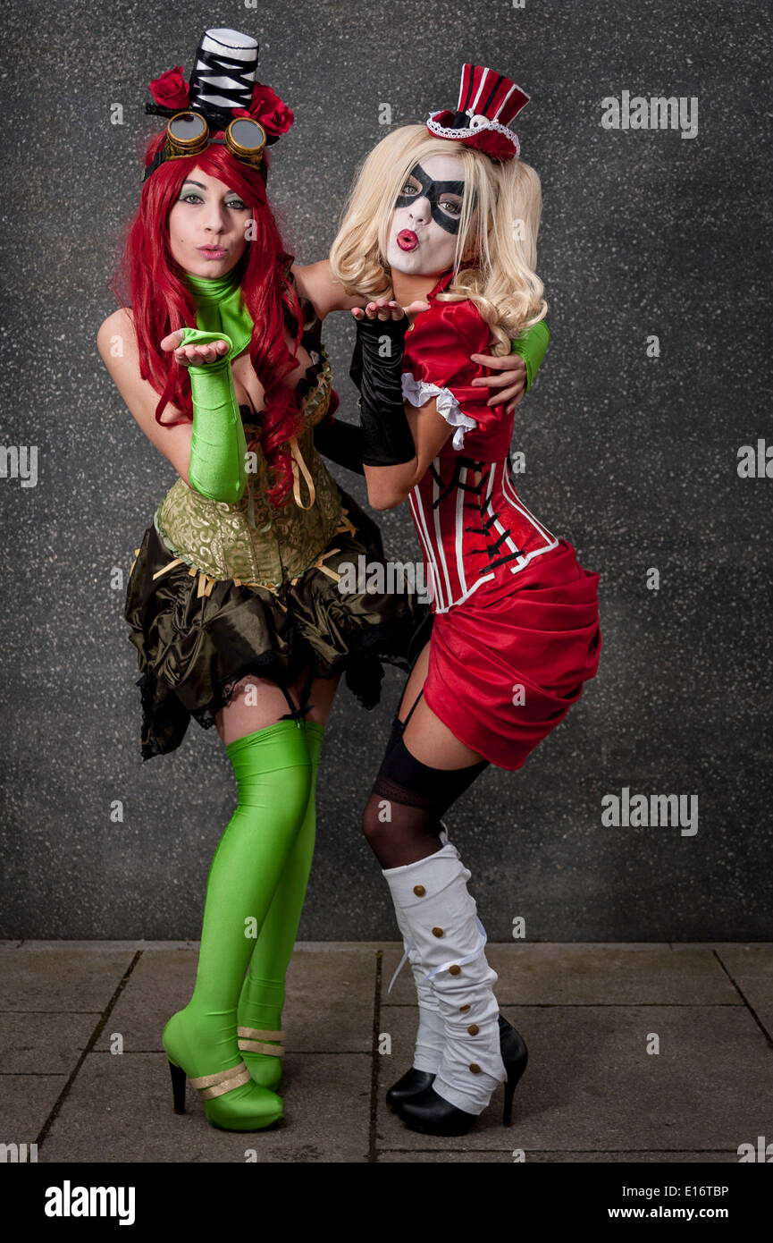 London, UK, 24 May 2014 - comic book fans and cosplay artists gather at the Excel Centre in Royal Victoria Docks at the bi-annual London Comic Con festival.  Many participants had spent a lot of money and time perfecting their costumes.  Pictured - Poison Ivy and Harlequin from Batman comic books. Credit:  Stephen Chung/Alamy Live News - Stock Image