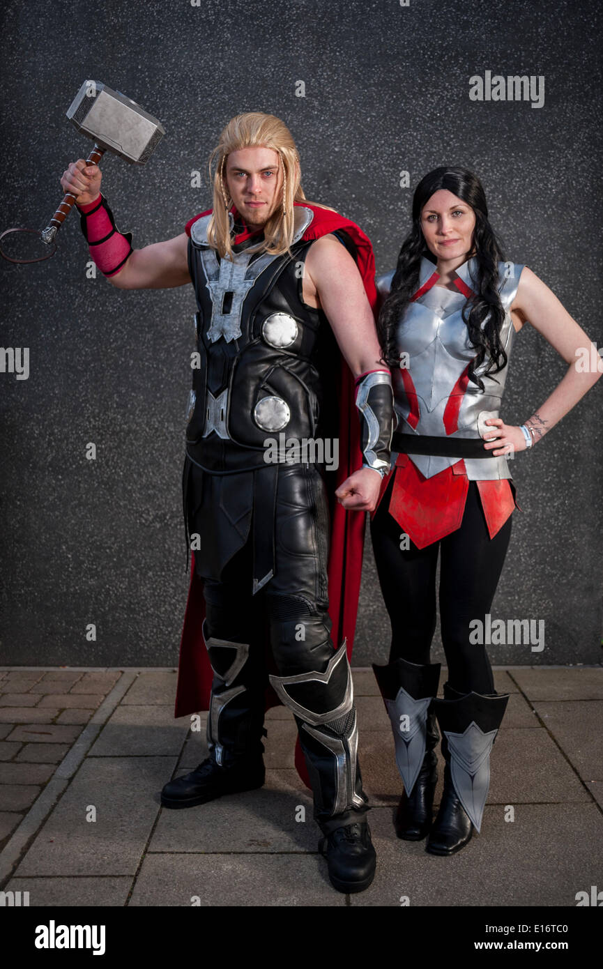London, UK, 24 May 2014 - comic book fans and cosplay artists gather at the Excel Centre in Royal Victoria Docks at the bi-annual London Comic Con festival.  Many participants had spent a lot of money and time perfecting their costumes.  Pictured - Thor and Sith from Marvel movies. Credit:  Stephen Chung/Alamy Live News - Stock Image