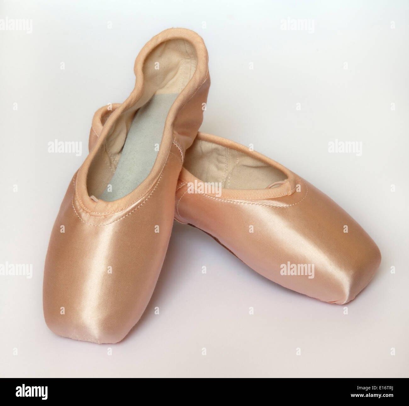 pair of pointe shoes on white background - Stock Image