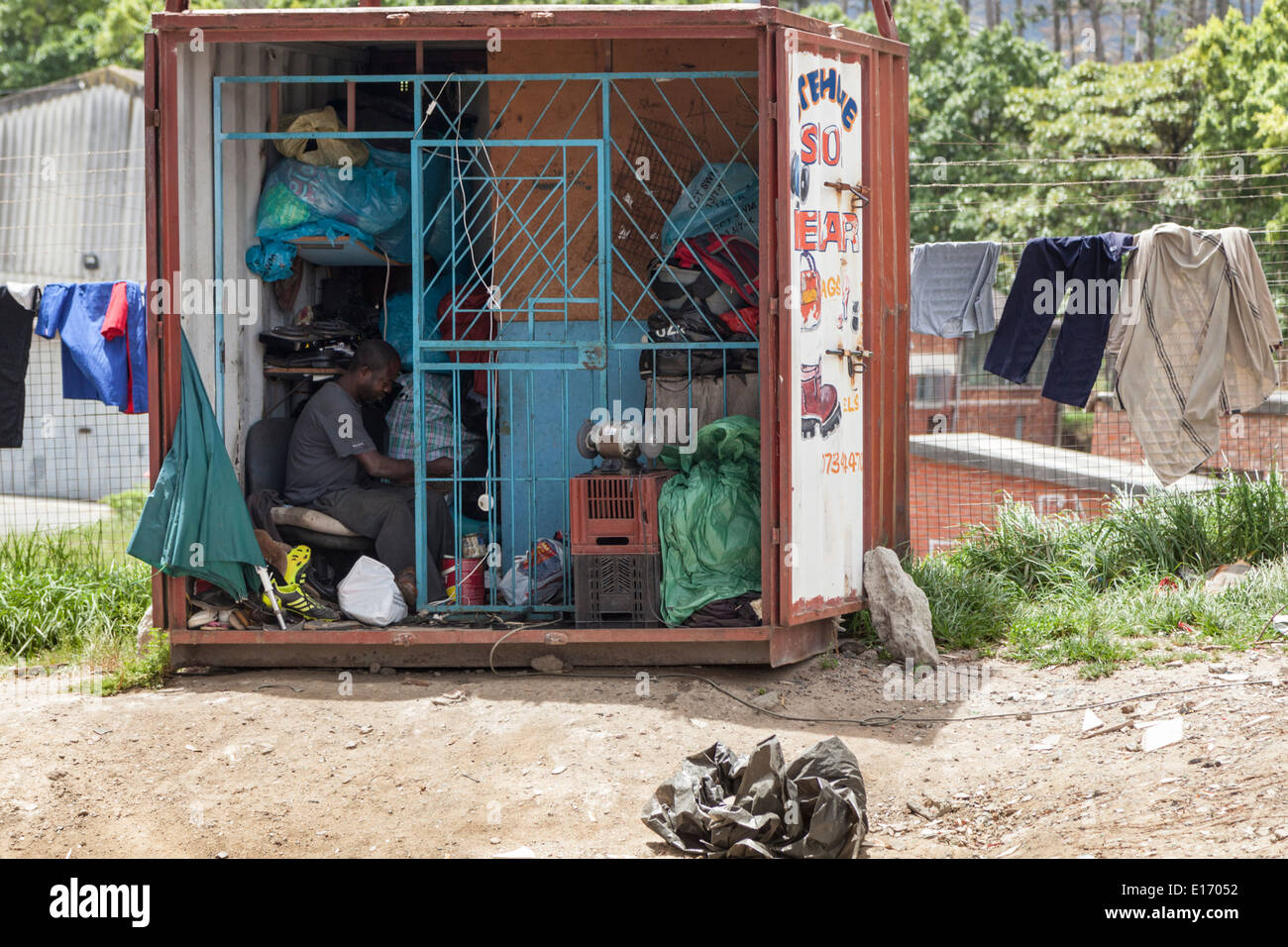 Shoe repair shop in a shipping container,  in Imizamo Yethu Township (Mandela Park), Cape Town, South Africa Stock Photo