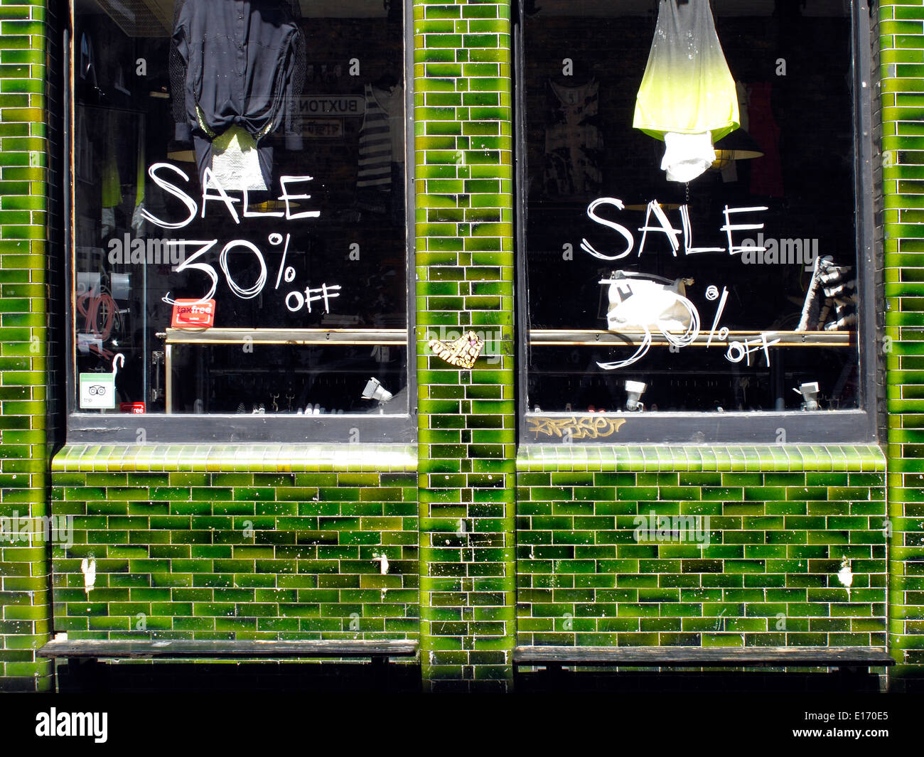 Shop windows on Buxton Street, off Brick Lane, Spitalfields,  East London, England, UK - Stock Image