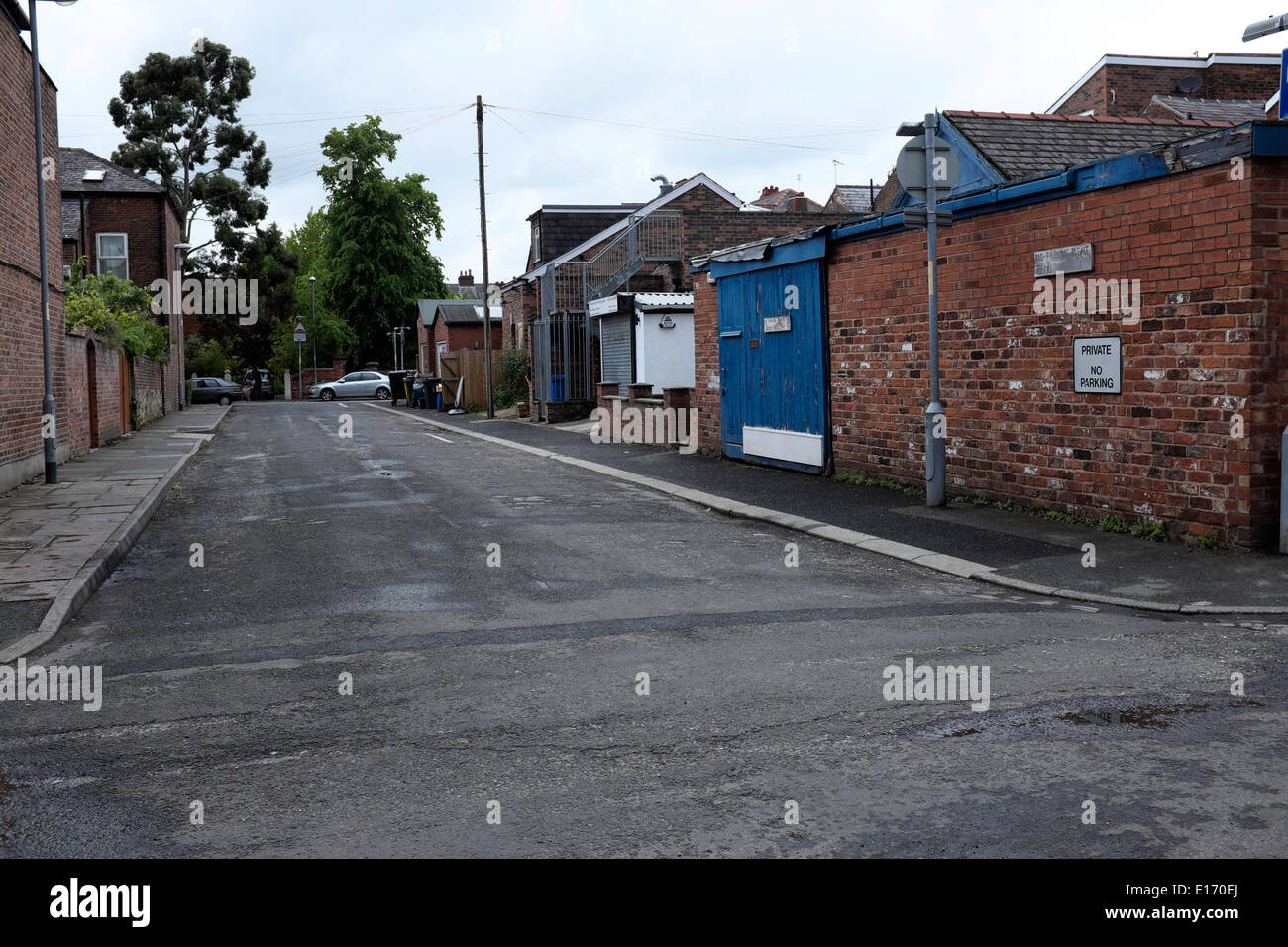a  suburban street with no parked vehicles - Stock Image