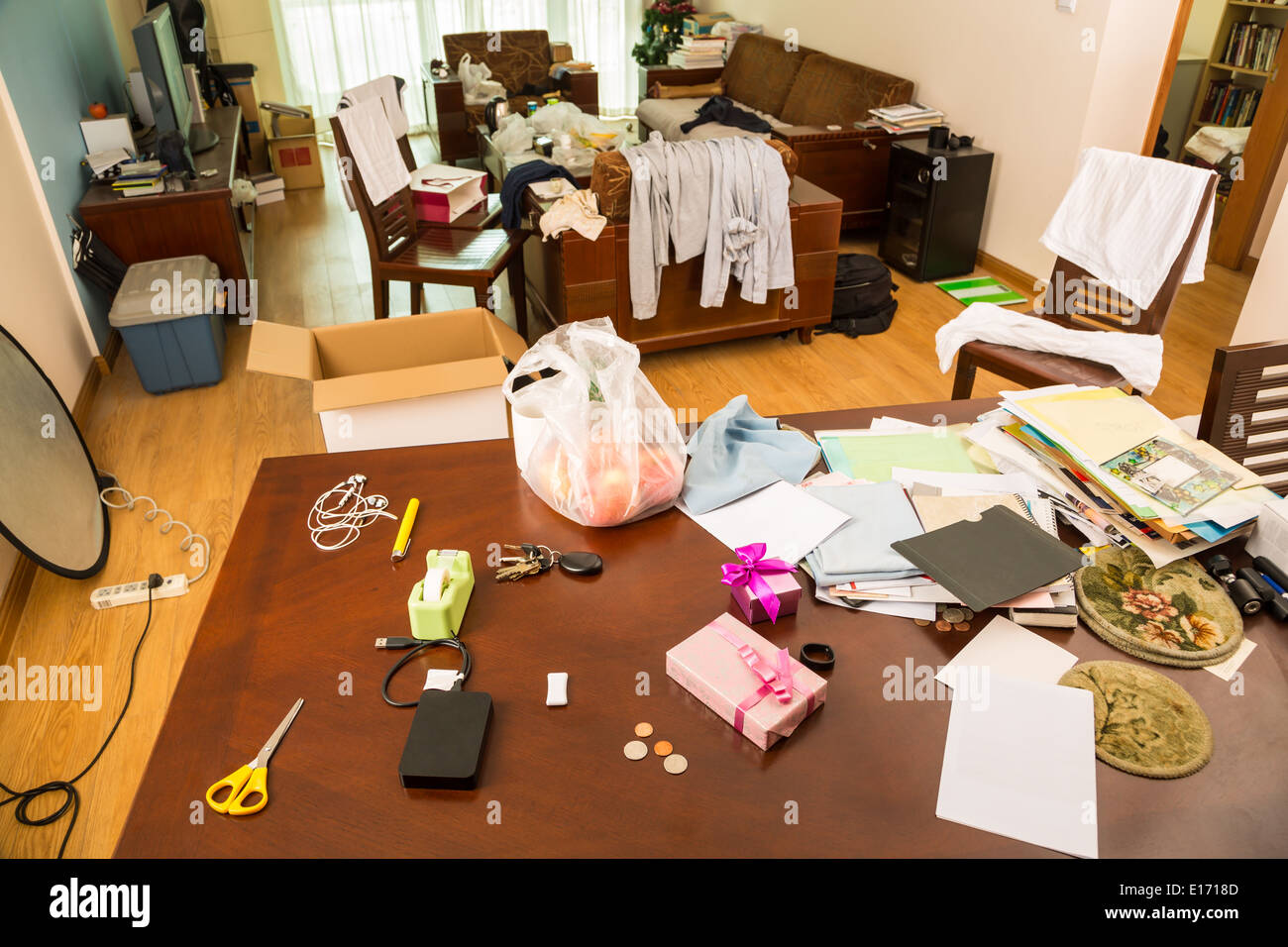 Messy living room with clothes and other stuff - Stock Image