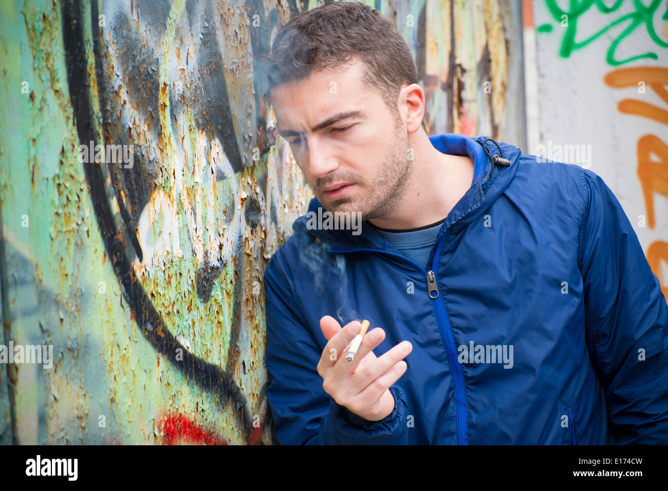 Man with smoke dependence - Stock Image