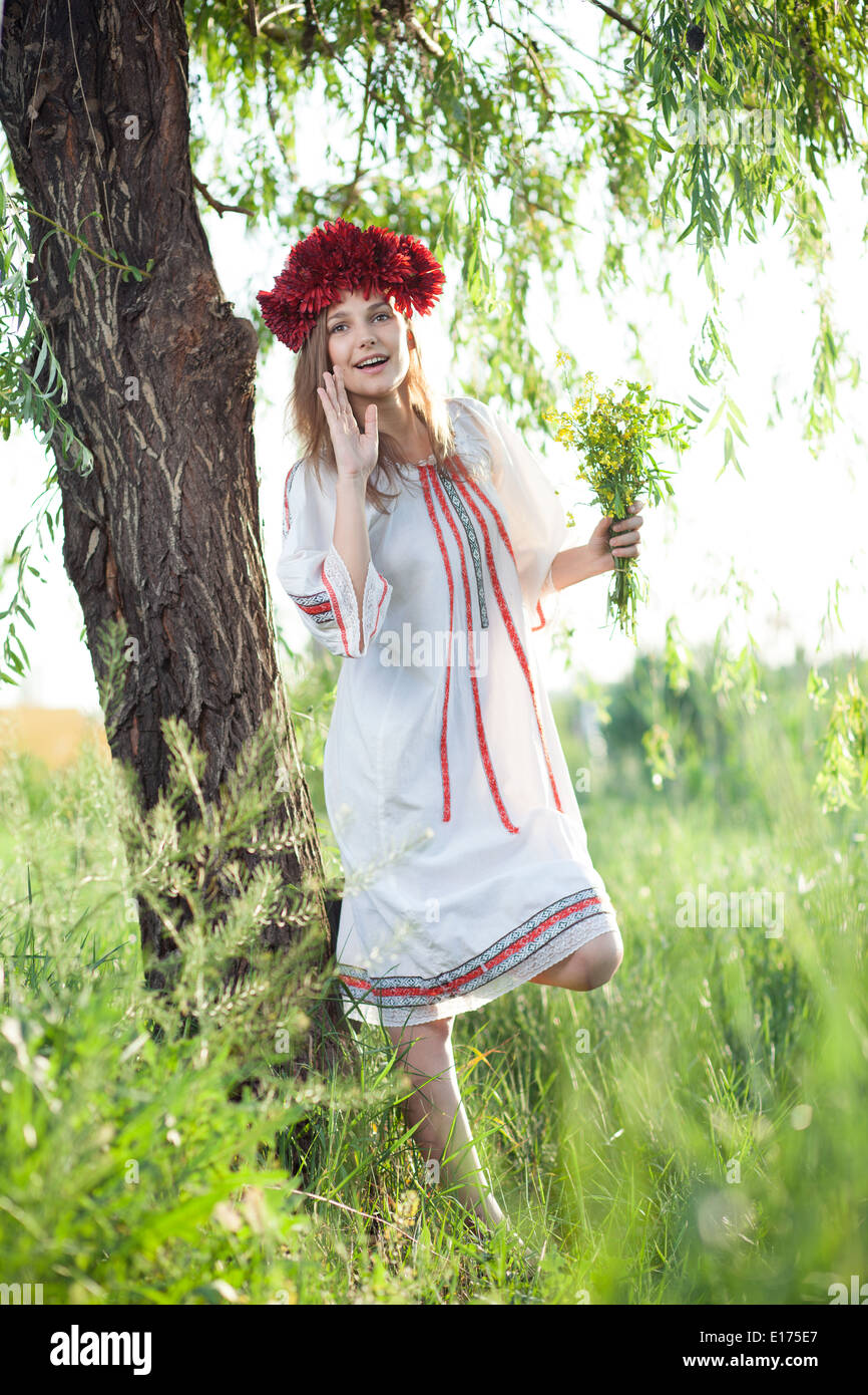 emotional girl in traditional ukrainian costume - Stock Image