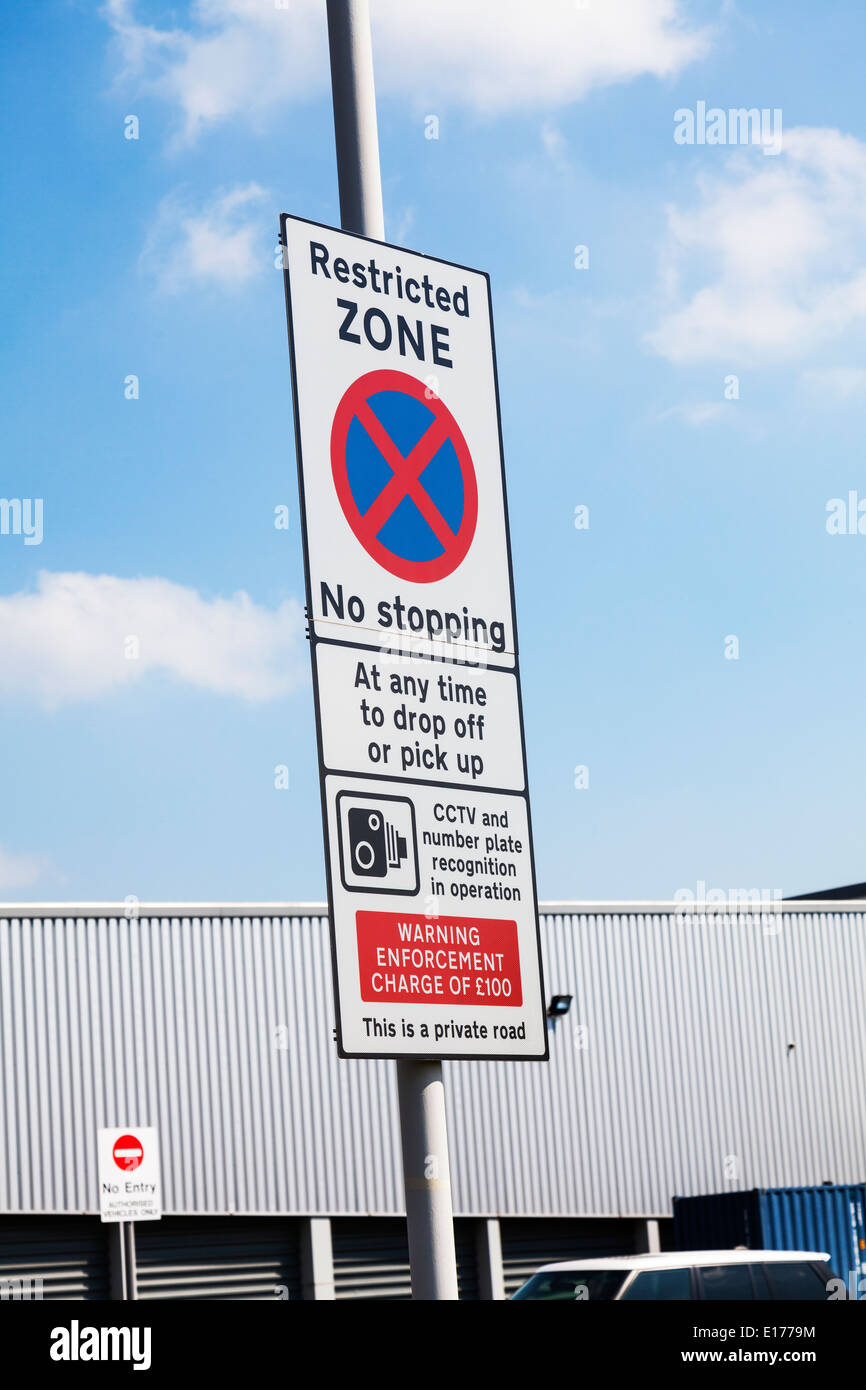 East Midlands airport restricted zone sign no stopping cctv enforced warning - Stock Image