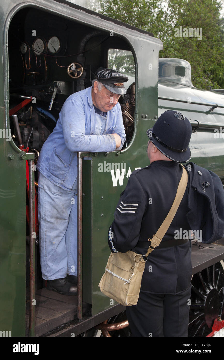 WWII train at Ramsbottom, Lancashire, UK. 25th May, 2014.  British waretime Police and steam Train driver at the Stock Photo