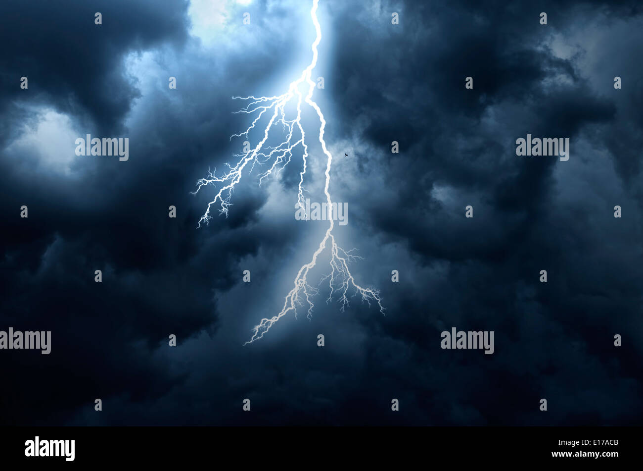 A lightning strike on the cloudy sky - Stock Image