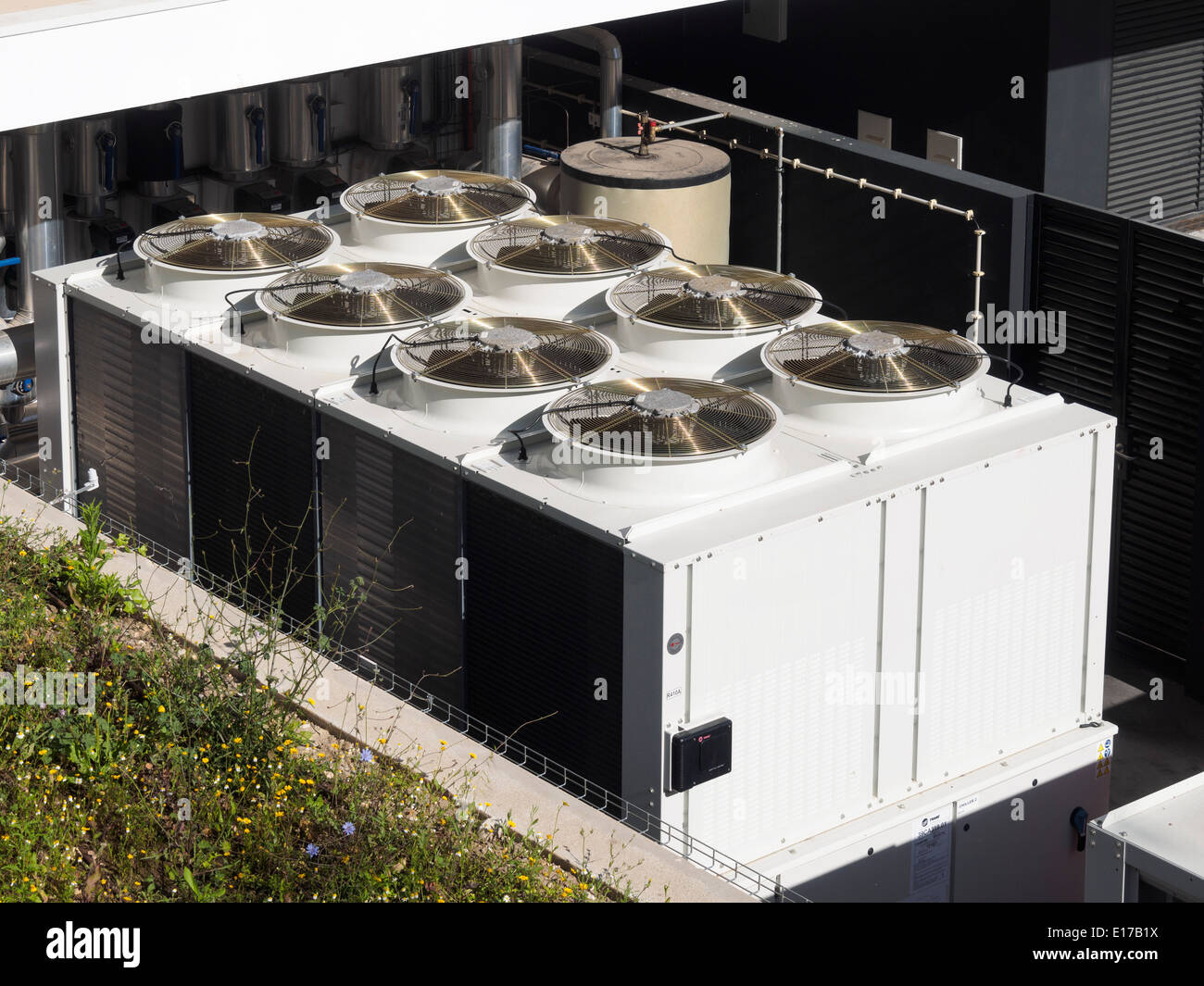 Large industrial air conditioning units on a building rooftop - Stock Image