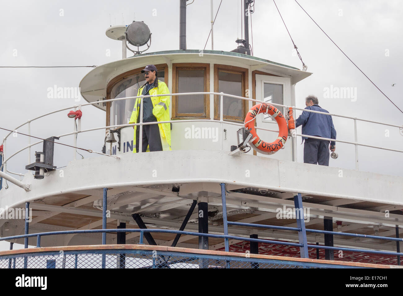 Captain of Toronto Ferry supervising the docking of his ferry at Ward's Islalnd in Toronto Ontario - Stock Image