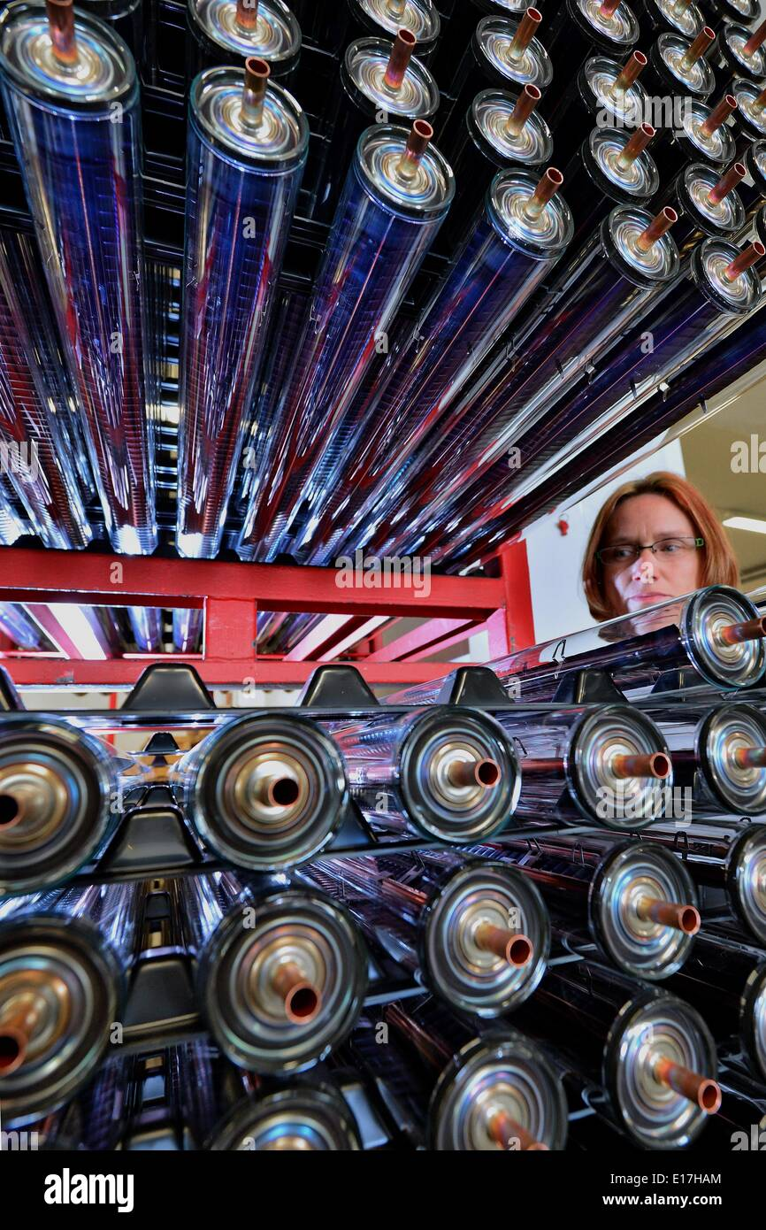 Brand-Erbisdorf, Germany. 29th Apr, 2014. Sylvia Oehme checks vacuum tubes for solar facilities at lamp manufacturer Narva in Brand-Erbisdorf, Germany, 29 April 2014. The company will soon celebrate the 500 millionth fluorescent lamp since it was privatized in 1991. Today, 400 Narva employees not only make 30 million fluorescent lamps a year, they also manufacture LED lights and vacuum tubes for solar applications. Their 50 million euro revenue is divided equally from Germany, Europe and the USA. Photo: HENDRIK SCHIMDT/dpa/Alamy Live News - Stock Image
