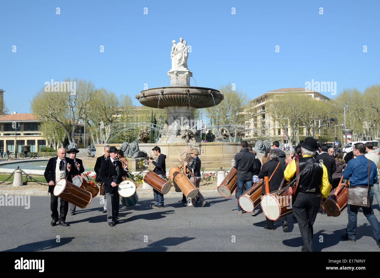 Provençal Musicians or Drummers Playing Traditional Tambourins Drums La Rotonde Fountain Aix-en-Provence France - Stock Image
