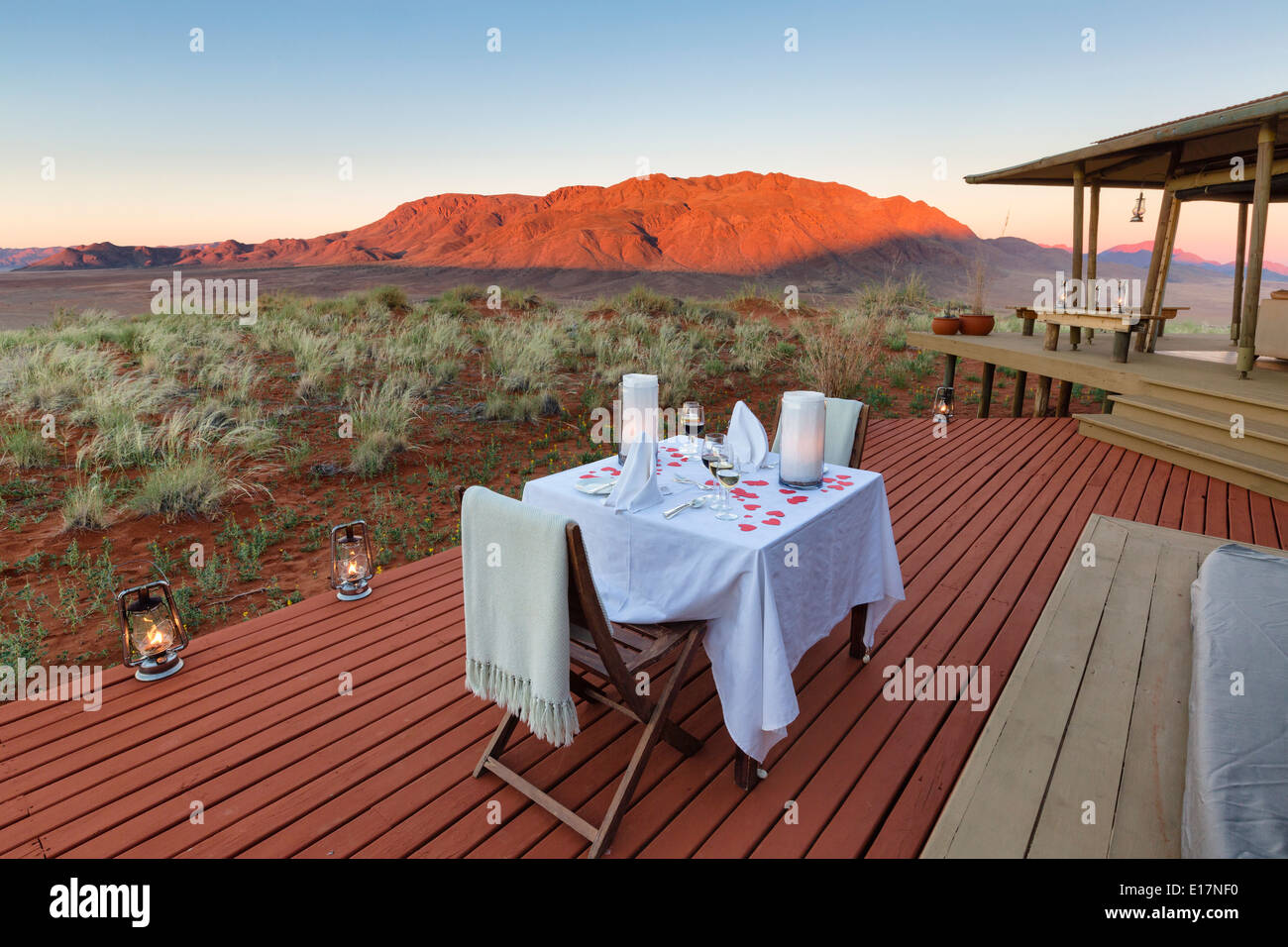 Romantic dining on deck area of mountain view suite.Dunes lodge.Wolwedans NamibRand Nature Reserve.Namibia - Stock Image