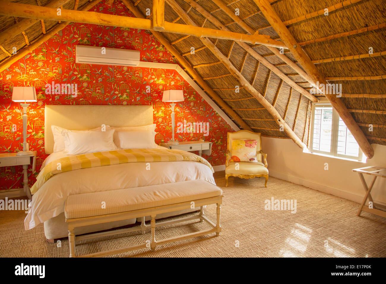 Luxury attic bedroom - Stock Image