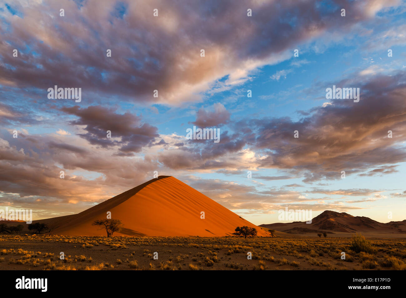 Sunrise on a sand dune with clouds above.Soussvlei.Namibia - Stock Image