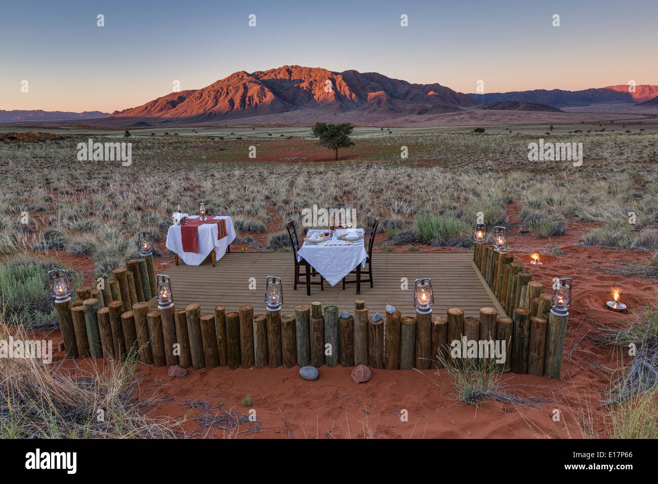Romantic dining at the Dune camp.Wolwedans NamibRand Nature Reserve.Namibia - Stock Image