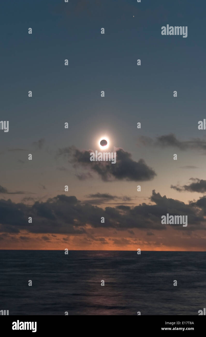 July 21, 2009 total solar eclipse near third contact as shadow leaves the horizon and is about to hit the Sun coming toward us - Stock Image