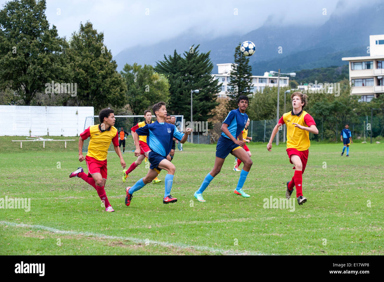 Junior football players heading the ball, Cape Town, South Africa - Stock Image